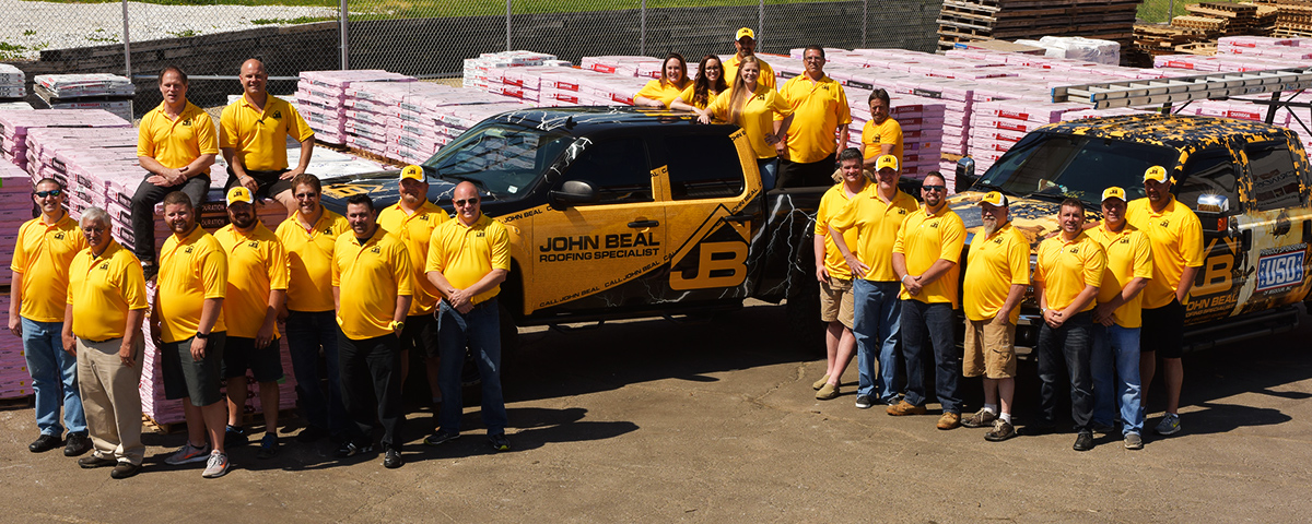 A group picture of the John Beal roofing contractors.