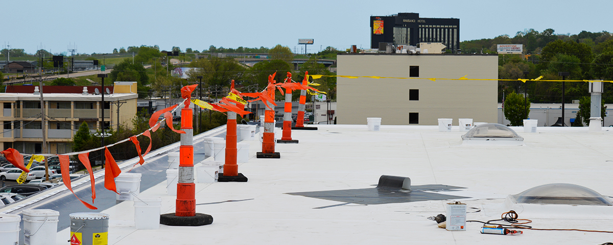 A commercial flat roof that is currently in progress of being installed.